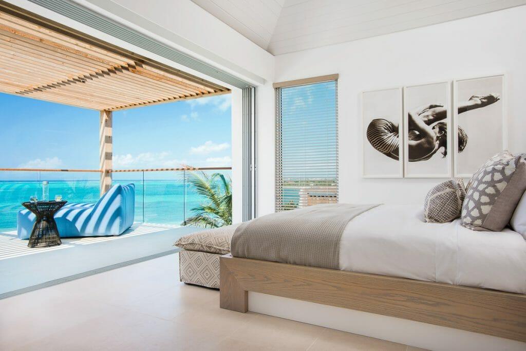 beautiful bedroom overlooking beach and sea