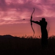 Man mastering bow and arrow