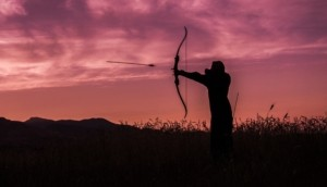 Man mastering bow and arrow